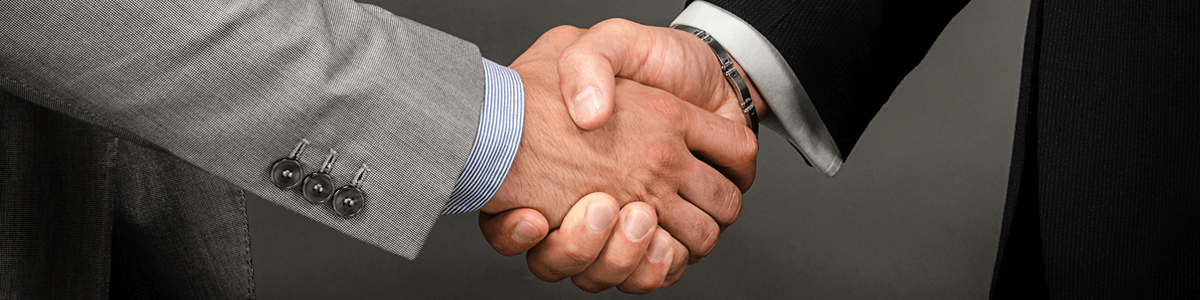 Two men shaking hands thanks to ETS surgery to treat hyperhidrosis