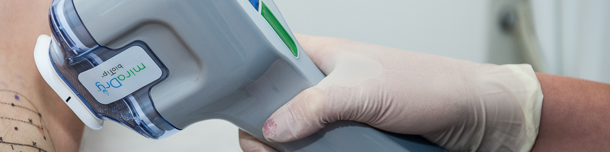 miraDry machine being used on a patient for excessive axillary hyperhidrosis