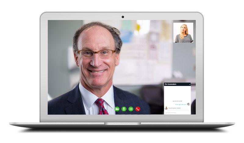 Dr. Lyall Gorenstein video chatting a patient through telemedicine on a laptop